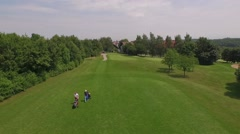 Two persons walking at the golf course Stock Footage