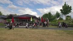 A few golf caddies in front of a golf club Stock Footage