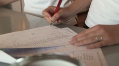 A woman checking a member list Stock Footage