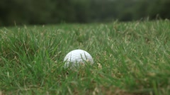Person picks up a golf ball Stock Footage