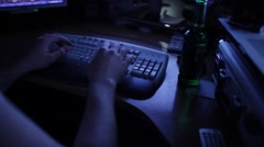 RIGA CIRCA 2015: System administrator works at night in dark room with computer Stock Footage