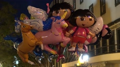4k Colorful kiddy ballons closeup city christmas night light - stock footage