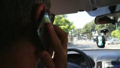 Driver taking a call while driving Stock Footage