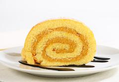 Swiss roll with peanut butter cream - stock photo