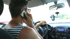 Holding mobile phone while driving Stock Footage