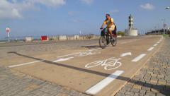 Bike rider on the walkaway Tel Aviv Jaffa Stock Footage