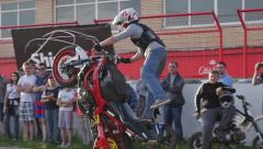 MOSCOW, CIRCA 2015:Amazing motorcycle tricks by professional stunt man Stock Footage