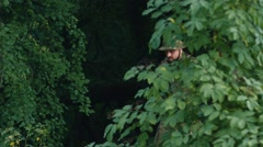 Armed men sneaking through the woods. Airsoft game Stock Footage