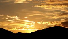 Evening sky time lapse and mountains silhouette Stock Footage