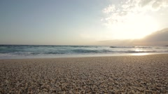 Tranquil idyllic scene of a golden sunset over the sea - stock footage