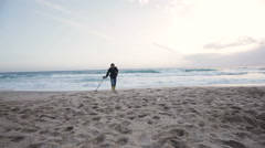 ALANYA, TURKEY - Man search for gold and silver jewelry in the sand Stock Footage