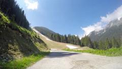 Mountain road over world ski cup ski slope Banderica in Bansko, Bulgaria Stock Footage
