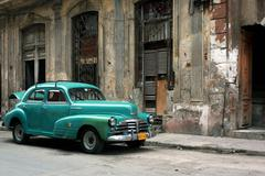 Havana, Cuba, old car and houses in the center in a desolate condition - stock photo
