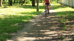 Stock Video Footage of Cyclist riding on a footpath