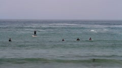 Unidentified surfers waiting for the waves at Morro Bay, California Stock Footage