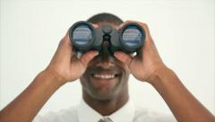 Young businessman looking through binoculars Stock Footage