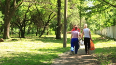 People go on a picnic on way Stock Footage
