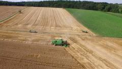 Aerial shot harvester field nice golden sunlight Stock Footage