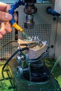 EDM machine for denture Kuvituskuvat