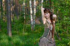 Young beautiful girl in the forest - stock photo