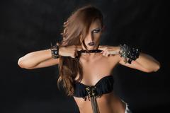 Fashion Rocker Style Model Girl Portrait. Hairstyle. Rocker or Punk Woman Makeup - stock photo