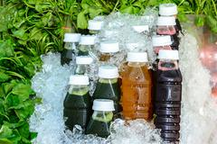 Asiatic juice, Chrysanthemum juice and Roselle juice in bottle on ice with as Stock Photos