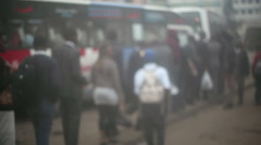People wait in line to board a bus in Nairobi, Africa Stock Footage
