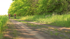 family riding a bicycle - stock footage
