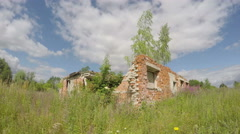 Rural house ruins on meadow and clouds motion. Timelapse 4K Stock Footage