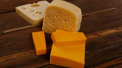 Various types of cheese on wooden table Stock Footage