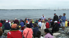 People attend Volvo Ocean Race in port race in Newport bay Stock Footage