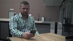 Man browsing phone at the table. Stock Footage