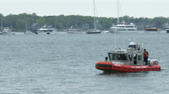 U.S. Coast guard boat patrols during Volvo Ocean Race in port race Stock Footage