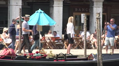 Man takes picture from his wife and gondola in front of Campo Erberia Stock Footage
