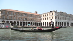 Gondalas in slow motion in front of Campo Erberia in Venice Stock Footage