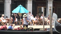 Gondolier takes picture from couple in gondola in front of Campo Erberia Stock Footage