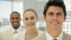 Multi-ethnic young business coworkers smiling in office - stock footage