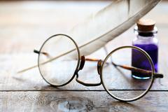Spectacles And Quill Stock Photos