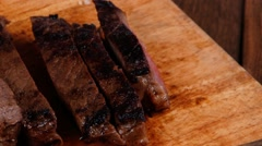 Red beef meat fillet mignon cutted on wood Stock Footage