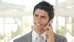 Happy businessman answering smart phone Stock Footage