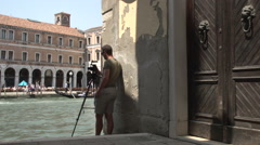 Cameraman takes picture from gondolas in front of Campo Erberia Stock Footage