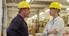 Portrait of two coworkers going through the orders in a warehouse Stock Footage