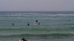 Surfers waiting for the waves at Morro Bay, California Stock Footage