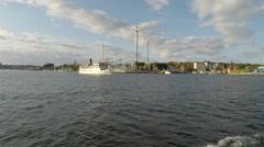 Steamboat in passes Gröna Lund ausement park - Stockholm Stock Footage