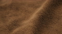 Brown polar fabric blanket close-up 4K 2160p UHD footage - Polar blanket text Stock Footage