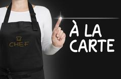 A la carte food touchscreen is operated by cook Stock Photos
