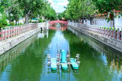 Water wheel floating on canal city. Stock Photos