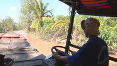 River bank and boats sailing at The Mekong Delta, Vietnam Stock Footage