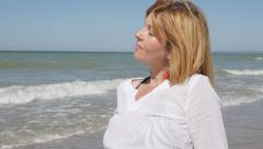 Slow motion  beautiful woman relaxing by the sea 1080p FullHD footage - Cauca - stock footage