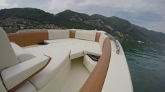 On board view of boat navigating fast on Como lake Stock Footage